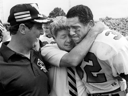 Sept. 29, 1984: Coach George MacIntyre, center, and