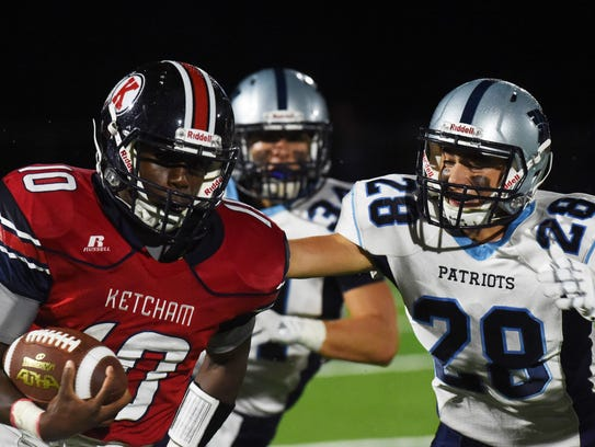 Ketcham's Delvaine Seagers, left, takes the ball down