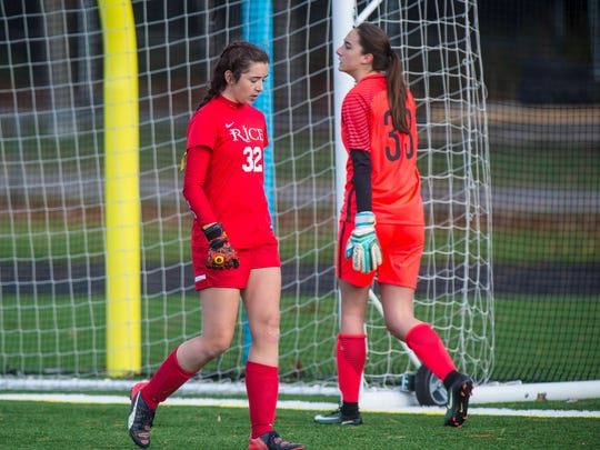 Rice Memorial goalie Hannah Miller, left, passes Miltongoalie Madison North as they take turns in the goal for two PKs after two overtimes in the girls Division 2 high school state championships in South Burlington on Saturday, November 4, 2017.