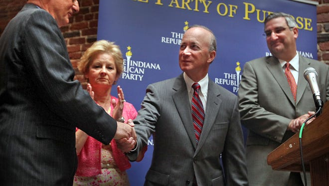 Eric Holcomb (from right) joined Gov. Mitch Daniels, Secretary of State  Connie Lawson and Treasurer Richard Mourdock on May 9, 2012, at Republican Party headquarters in Indianapolis.  Holcomb worked closely with Daniels for many years and is now running for governor himself.