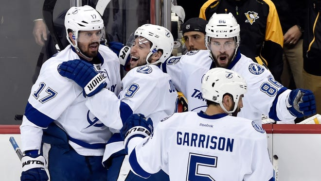 ampa Bay Lightning center Alex Killorn (17) celebrates with teammates after scoring a goal against the Pittsburgh Penguins during the first period in Game 1 of the Eastern Conference Final.