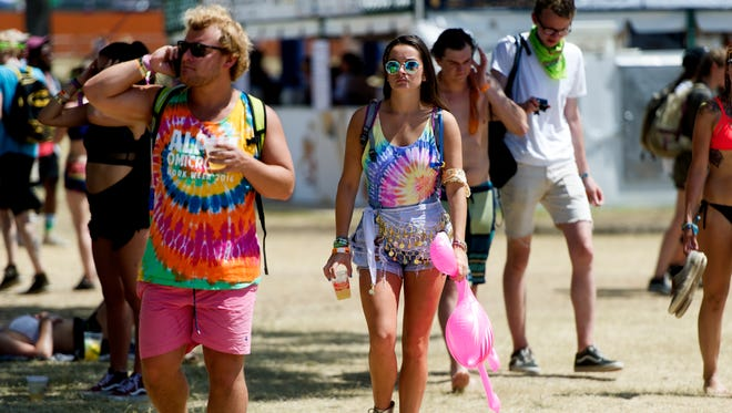 Fest-goers walk through the park at Bonnaroo Music and Arts Festival in Manchester, Tennessee on Sunday, June 11, 2017.