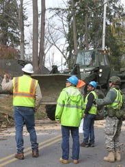 Members of the Army National Guard work with Con Edison