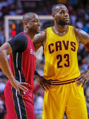 Miami Heat guard Dwyane Wade is greeted by Cleveland Cavaliers forward LeBron James.
