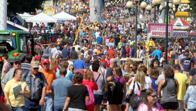 Throngs of fairgoers pack the Grand Concourse at the Iowa State Fair.