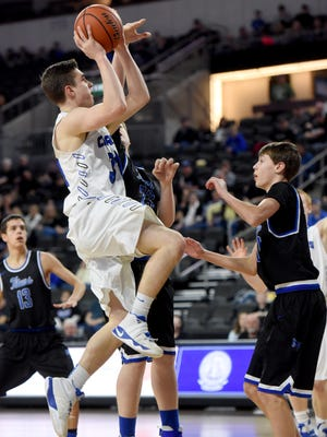 Sioux Falls Christian's Tyler Van Horssen goes up for a shot while Mt. Vernon/Plankinton Brady Andersen defends  during the Class A boy's basketball quarterfinals on Thursday at the Denny Sanford Premier Center.