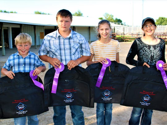 Earning first place in the junior division at the State 4-H Livestock Judging contest held July 24 in Lodi was the Grant County team (from left) Brendan Jentz, Gavin Esser, Jessica Patterson, and Avery Crooks.