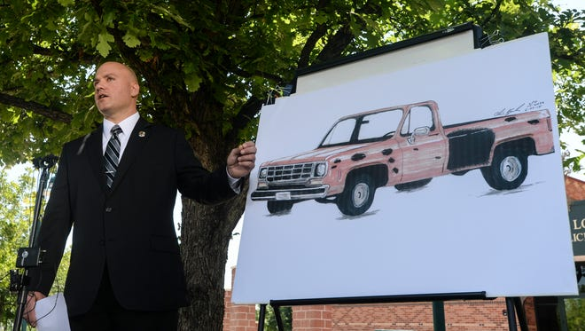 David Moore, public information officer for Larimer County Sheriff's Office, speaks about an artist's rendering of a pickup believed to be a vehicle of interest in the June 3 shootings in Loveland during a press conference at the Loveland Police Department, Tuesday, June 23, 2015 in Loveland, CO.