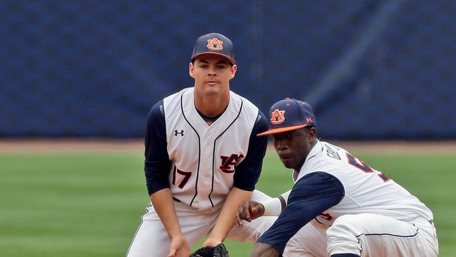 Auburn's Melvin Gray (5) fields a throw from the catcher as Cody Nulph (17) backs him up at second base during the first inning of a game at the Southeastern Conference college baseball tournament at the Hoover Met, Thursday, May 21, 2015, in Hoover, Ala. (AP Photo/Butch Dill)