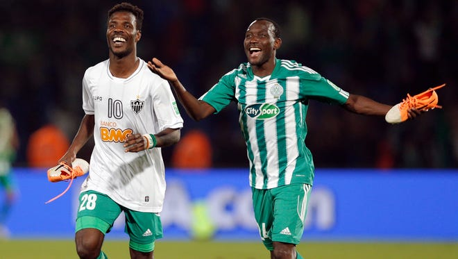 Raja Casablanca's Kouko Guehi, left, and Vivien Mabide celebrate after defeating Atletico Mineiro.