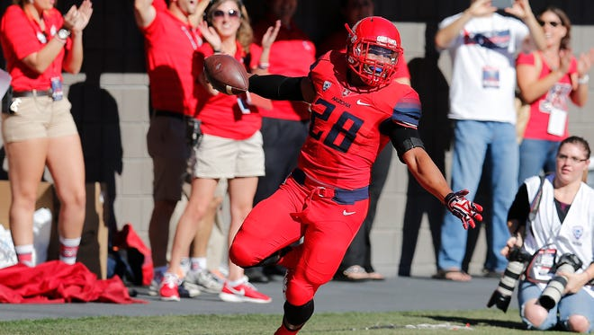 Arizona safety Anthony Lopez celebrates after recovering a fumble for a touchdown during the first half against Arizona State on Friday.