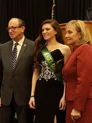 Samantha Eristavi, center, at the Board of Agriculture Delegates Dinner with NJ Sec. of Agriculture Douglas Fisher, left, and Lt. Governor Kim Guadagno, right.