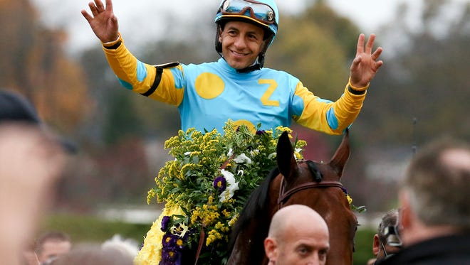 Victor Espinoza celebrated on his way to the winner's circle after he rode American Pharoah to win the Breeder's Cup Classic at Keeneland.Oct. 31, 2015