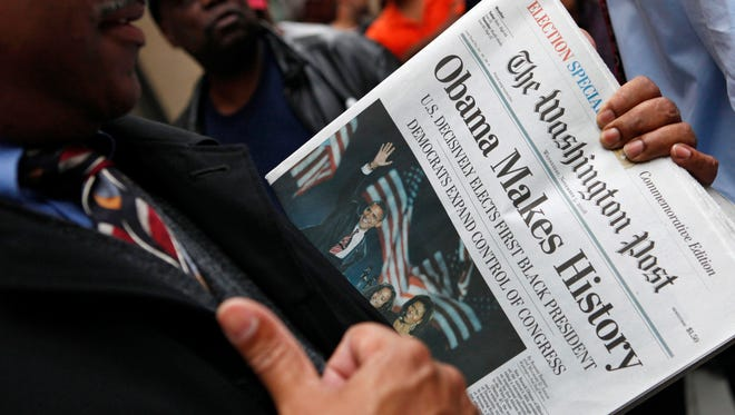 In this Nov. 5, 2008, file photo, people line up outside of the Washington Post newspaper to purchase special election editions in Washington. Newspapers are printing extra copies and setting up temporary retail stands after recalling the frenzy for an ink-stained memento after Barack Obama's historic win in 2008. Many people now rely on Facebook and apps for news, but a screenshot doesn't have quite the same romance as a newspaper's front page. (AP Photo/Haraz N. Ghanbari, File)
