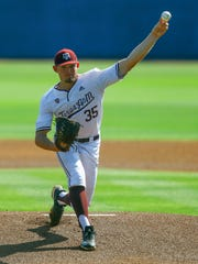 Texas A&M pitcher Asa Lacy throws a pitch during the first inning of the Southeastern Conference tournament NCAA college baseball game against Florida, Tuesday, May 21, 2019, in Birmingham, Ala. (AP Photo/Butch Dill)