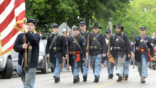Members of the Champlain Valley Historical Reenactors march in the Vergennes Memorial Day parade Monday.