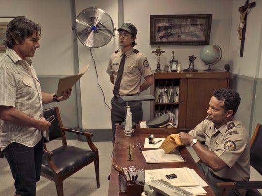 Barry (Tom Cruise, from left), his translator (Felipe