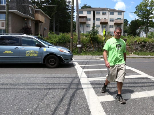 Ramapo Police Officer Omar Olayan works undercover at a crosswalk on Rt. 306 in Monsey June 28, 2017. They were giving tickets to motorists who didn't stop for pedestrians.