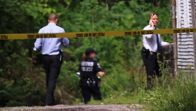 Police on the scene of a man found dead near 31st Street and River Park Drive.