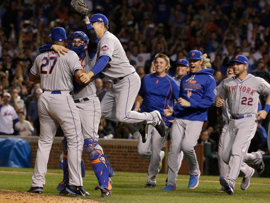 The New York Mets celebrate after Game 4 of the National League baseball championship series against the Chicago Cubs Wednesday, Oct. 21, 2015, in Chicago. The Mets won 8-3 to advance to the World Series. (AP Photo/Nam Y. Huh)