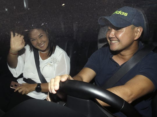 Keiko and Hiro, daughter and son of Peru's former President Alberto Fujimori, arrive to the clinic where their jailed father was admitted the previous day after suffering a drop in blood pressure in Lima, Peru, Sunday, Dec. 24, 2017. Peru's president announced Sunday night that he granted a medical pardon to the jailed former strongman who was serving a 25-year sentence for human rights abuses, corruption and the sanctioning of death squads. (AP Photo/Martin Mejia)