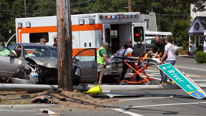 A woman injured in a single-car accident at Route 88 and River Avenue in Point Pleasant Tuesday is loaded into an ambulance.