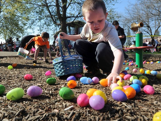 Hundreds of children swarm onto the Yoctangee Park playground at the start of last year's annual Chillicothe Jaycees Easter Egg Hunt to collect the 12,000 eggs filled with candy, toys and prizes.