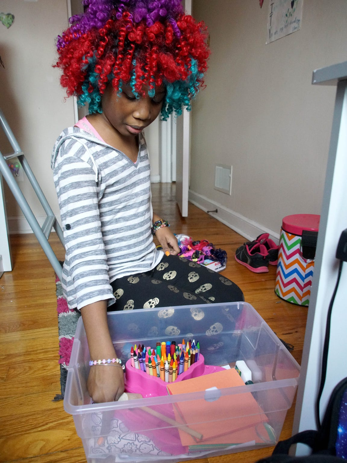 Trinity plays with toys in her room.