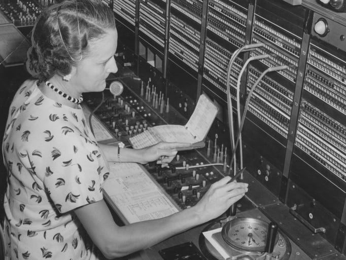 Telephone operator Martha Bennett uses the new telephone switchboard equipment in the Indianapolis long-distance facilities at 3959 Central Ave. in 1956.
