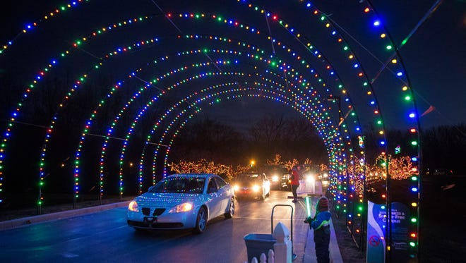 Cars drive through the Holiday lights at Gresham display on Dec. 15 at Suzanne Gresham Center campus, 3620 W. White River Boulevard. The display will be available to the public for this weekend and next before Christmas Eve.