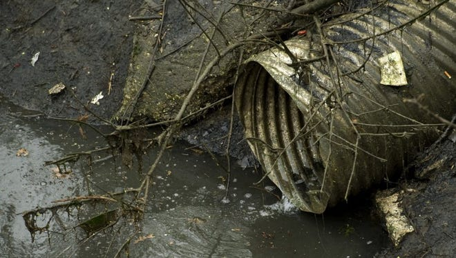A sewer pipe drains into Bee Slough near Shawnee Drive. Parts of the water way will be upgraded and replaced as part of the cities combined sewer overflow project.