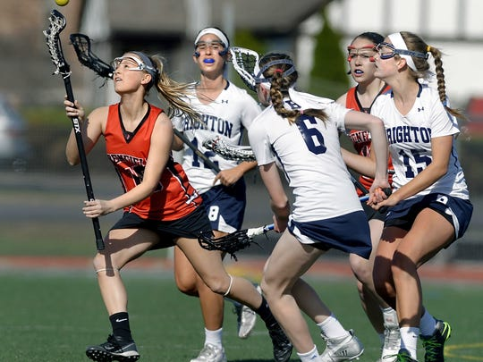 Penfield's Lindsay Gamer, here emerging from a crowd of players going after a loose ball, scored 45 goals and eight assists last season for the Patriots.
