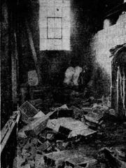 A Tribune photo shows the damage from a 1956 explosion