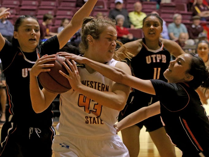 Midwestern State's Liz Cathcart works to keep the ball