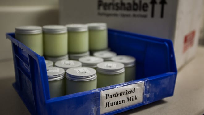 Jars of donated breast milk sit in storage at the Dixie Regional Medical Center in 2013.
