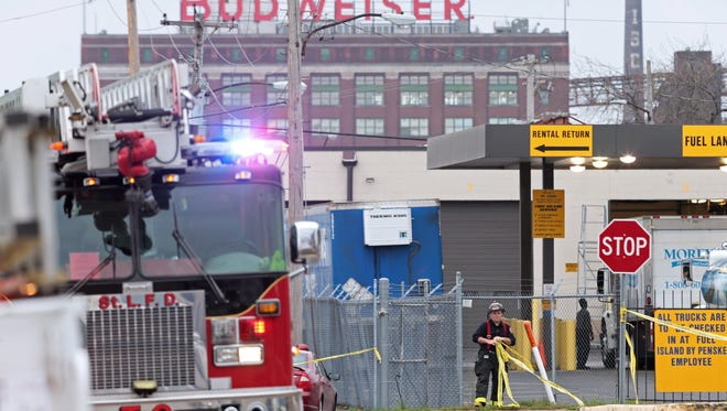 Crews work at the scene after a boiler exploded at a roof of a St. Louis box company and flew before crashing through the roof of a nearby laundry business on Monday, April 3, 2017. Authorities said several people were killed as a result of the explosion. (Cristina M. Fletes/St. Louis Post-Dispatch via AP)