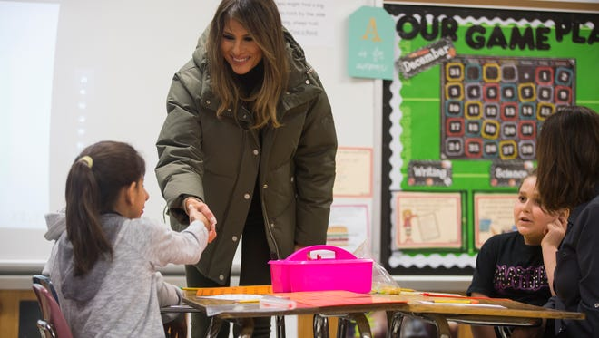 First lady Melania Trump greets students as they work Wednesday, Dec. 6, 2017, during a visit to Charlie Marshall Elementary School in Aransas Pass.