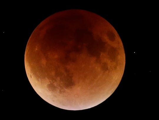 A lunar eclipse of a blood moon over Bayside on Sept.