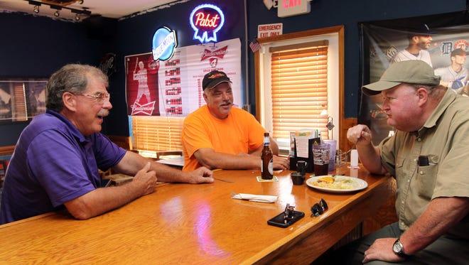 "Shakey Shaw (left) talks with longtime customers Dave ""Dog"" Doger of Walton and Tim Jackson of Burlington."