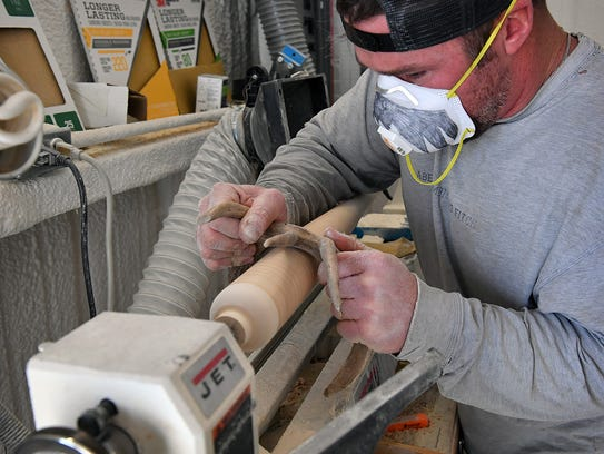 Ross Harrison of Xylo Bats uses a deer antler to harden