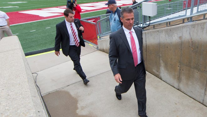 Ohio State Buckeyes head coach Urban Meyer enters Camp Randall Stadium prior to the game against the Wisconsin Badgers.