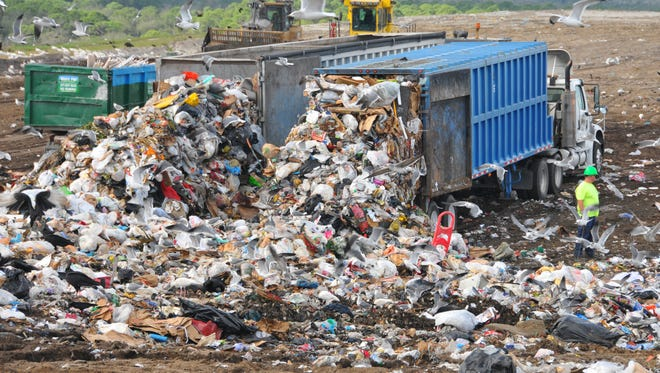 The holidays mean company,  gifts, packages,  food and wrapping paper that all translate into more trash. The Brevard County Solid Waste  Central Disposal facility in west Cocoa was hopping Monday morning as the trucks rolled in.