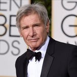 Video of Harrison Ford flying over an plane surfaces