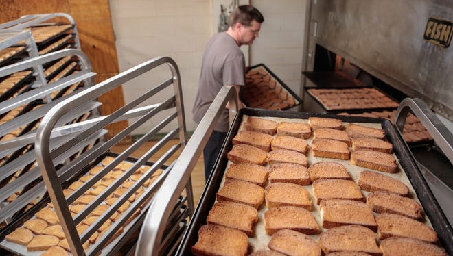 Anthony Stone loads trays of cinnamon toast to bake on Nov. 17 at Trenary Home Bakery  in Michigan's Upper Peninsula.