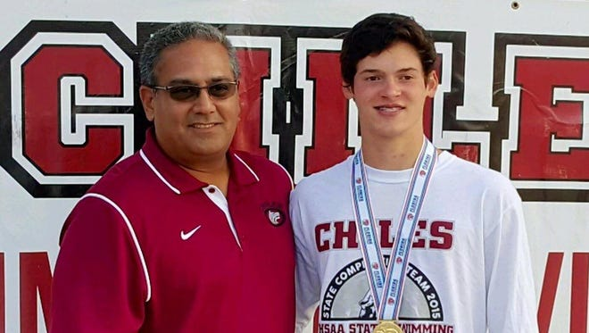 Chiles junior Chase Lane, with athletic director Mike Eto, captured a second consecutive 1-meter diving state title. Lane has only been diving for three years after switching over from gymnastics.