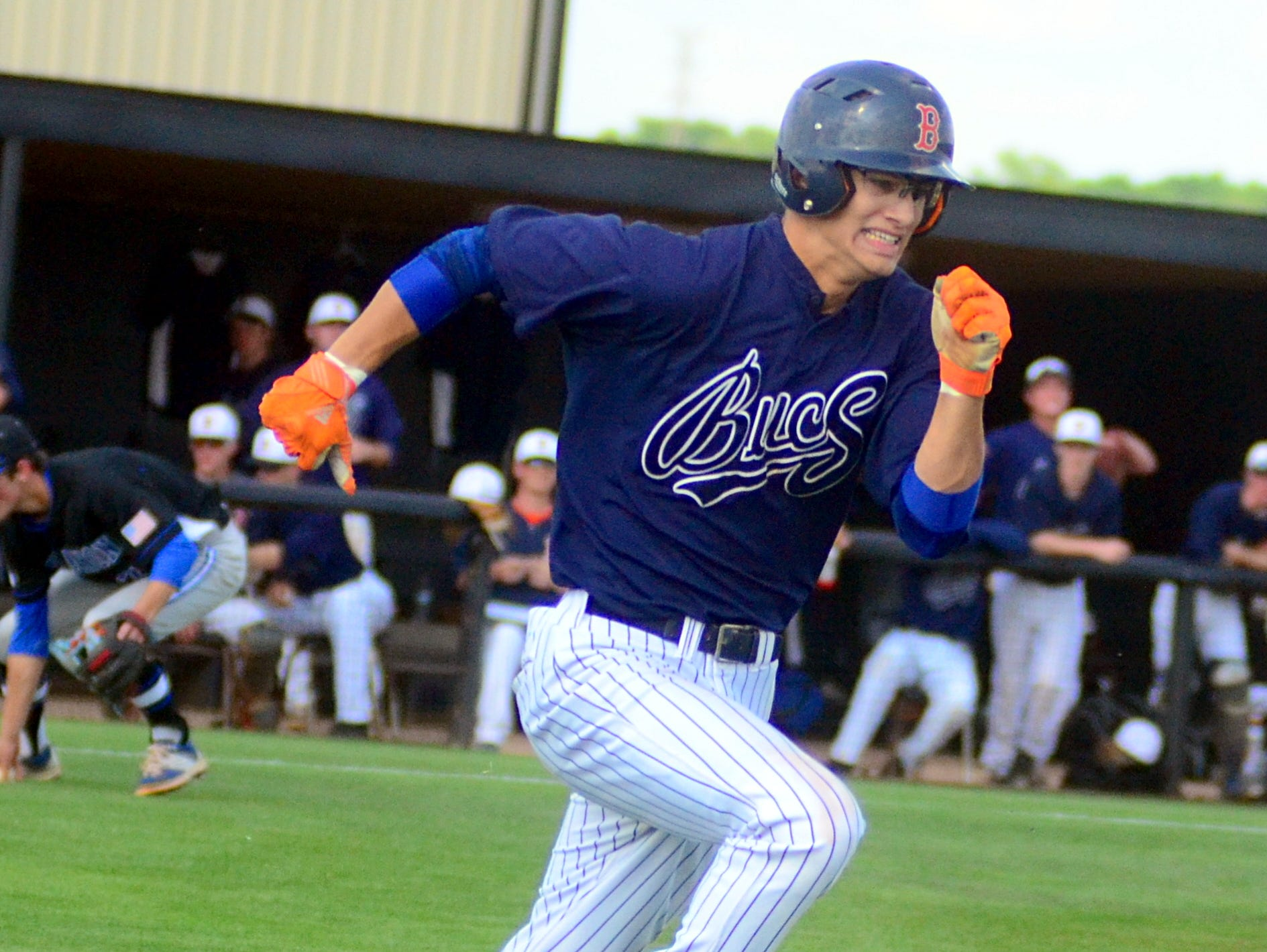 Beech High senior Jacob Jenkins runs down the first-base line during second-inning action. Jenkins singled in the second inning.