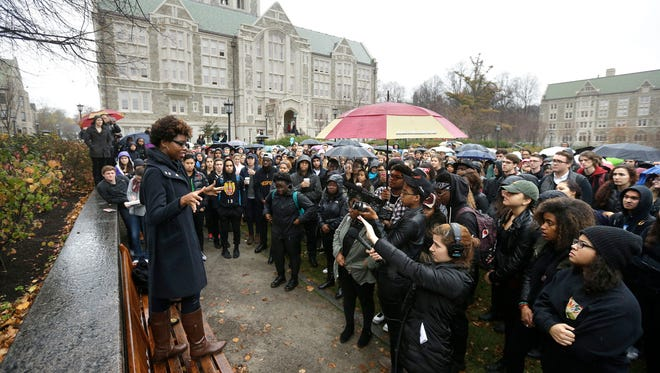 Students at Boston College listen to a speaker as they gather during a solidarity demonstration on the school's campus on Nov. 12, 2015, in Newton, Mass.