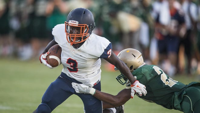 Escambia's running back Antonio Benjamin shakes off Lincoln cornerback Kai Davis Jr. during a touchdown run in their preseason game at Chiles High School.