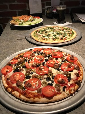 Pizza pies and salads from  Ricardo's Pizza, 5627 Broad St. in Greendale, Wi.