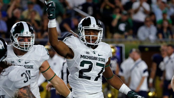 Michigan State safety Khari Willis celebrates a fumble recovery on a punt during the first half of an NCAA college football game against Notre Dame, Saturday, Sept. 17, 2016, in South Bend, Ind.